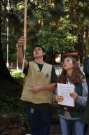 Student collecting data in a forest.