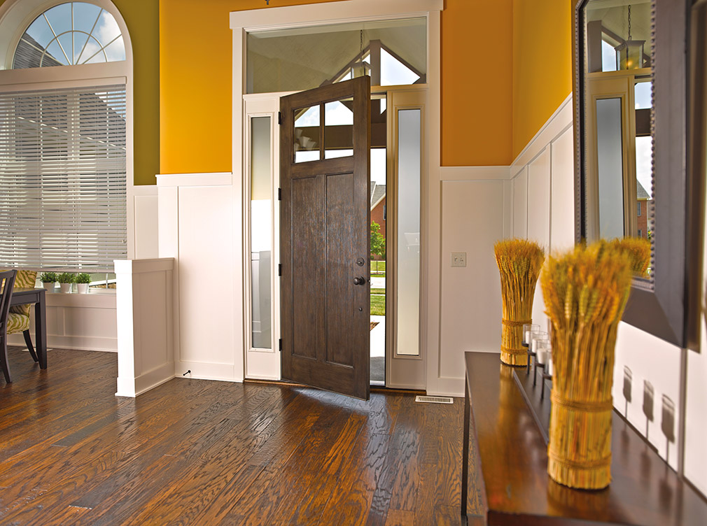 Interior doors leading out of a living room.