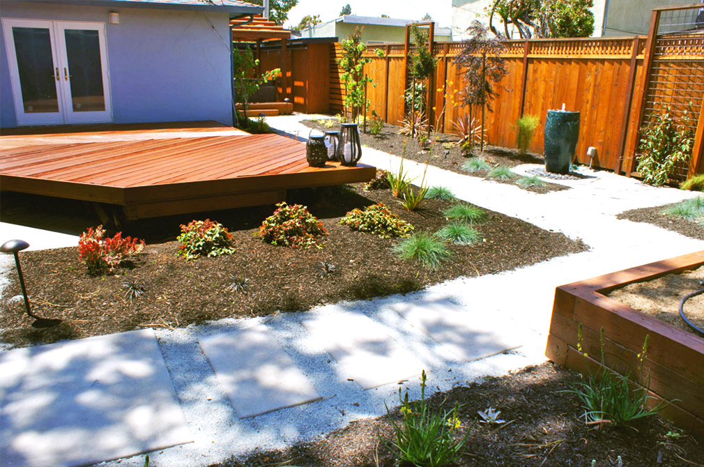 Backyard with new deck, redwood fencing and landscaping.