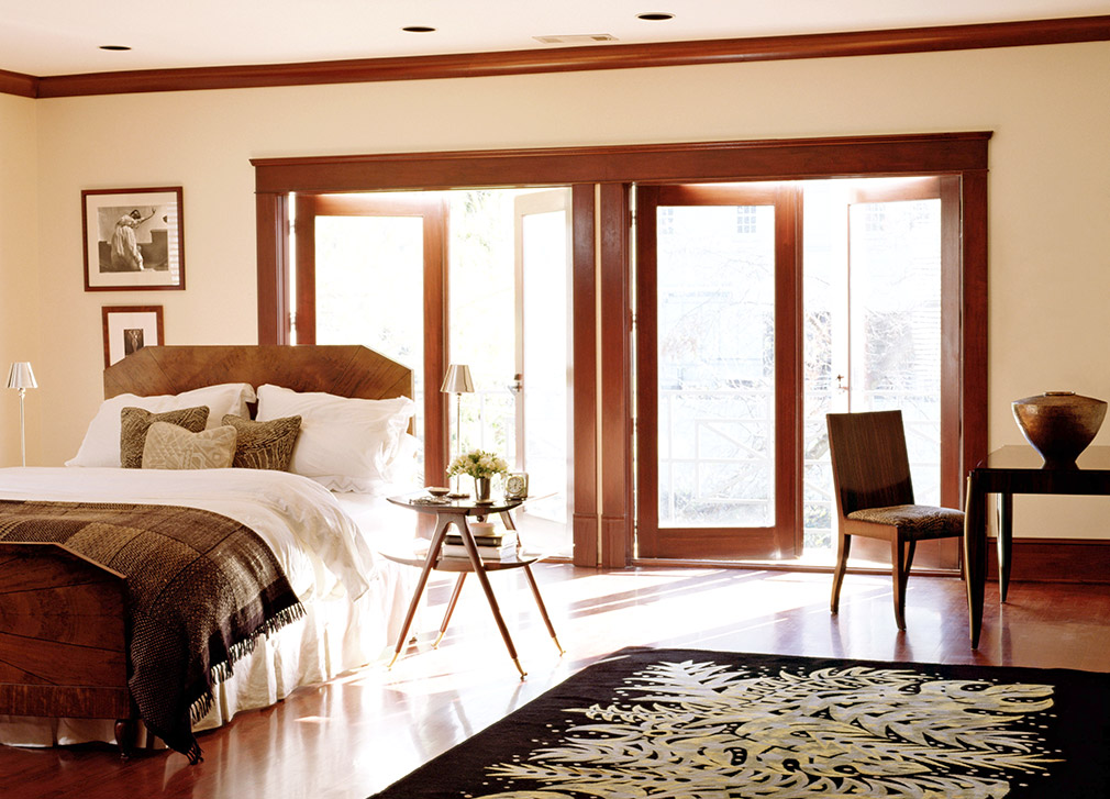 Bedroom interior with wooden crown moulding