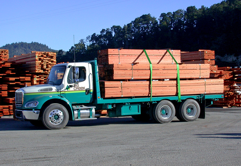 Delivery truck with stacked redwood planks