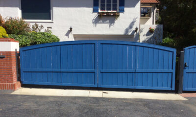 Blue gate in front of house