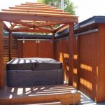 View of hot tub with pergola.