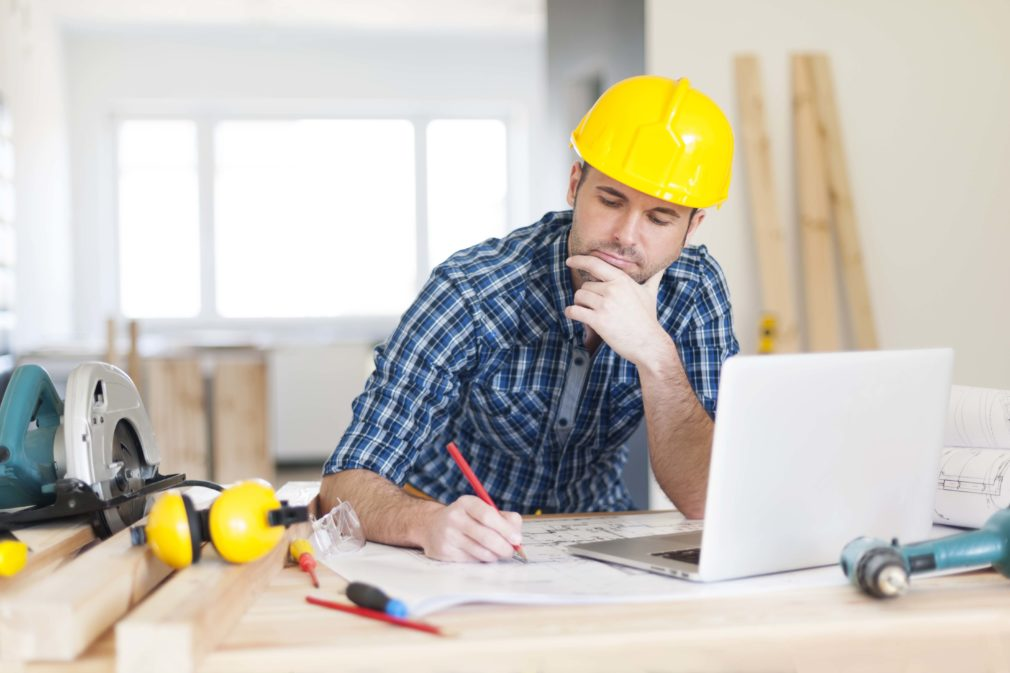 Contractor sitting at a table on a laptop