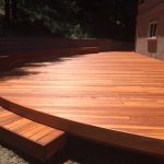 Curved redwood deck.