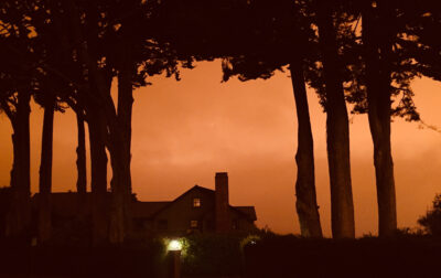 Home with eerie sunset behind it