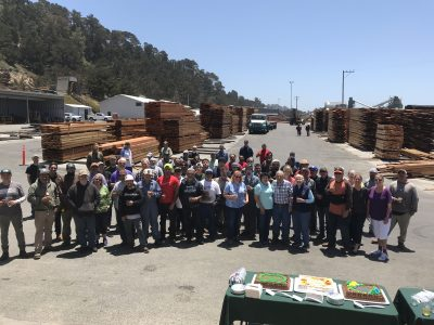 Group photo of men and women employees at big creek lumber