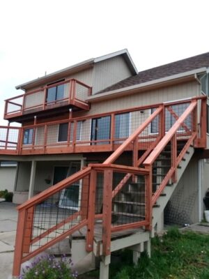 Redwood deck on a house with stairs and a redwood railing
