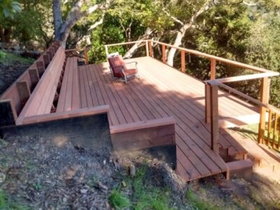Redwood deck and stairs with a railing
