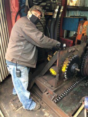 Man working on mechanical equipment