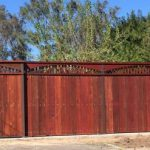 Large redwood fence.