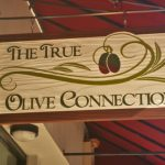 redwood sign for The True Olive Connection.
