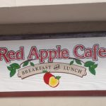 Redwood sign for Red Apple Cafe.