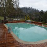 Redwood deck around pool.