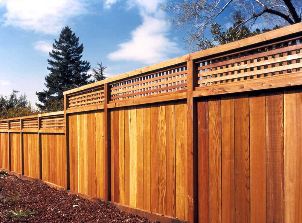 Redwood Fence Backyard redwood fence with lattice.